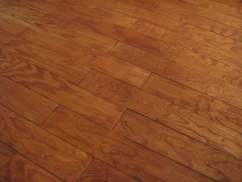plywood floor stained brown