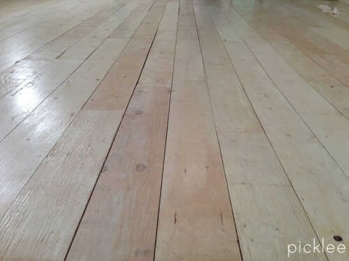 white wash wide plank plywood floor