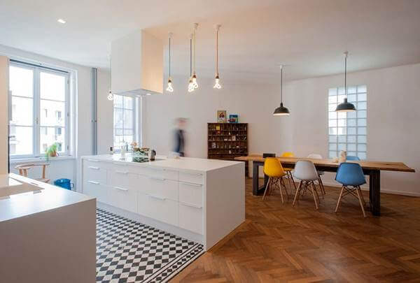 checkerboard tiles in the kitchen area are a nice touch in this contemporary open plan space - Kitchen Floor Tile Design Ideas