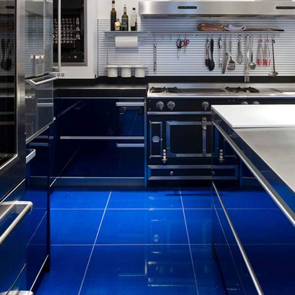 These Glossy Electric Blue Tiles Are Beautifully Dramatic Against The  Utilitarian Kitchen Fittings.