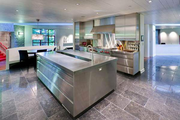 This Rugged Stone Floor Is A Great Compliment To The Stainless Steel Kitchen .