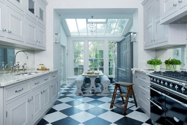 Classic checkerboard marble tiles are beautifully updated in the glamorous kitchen.