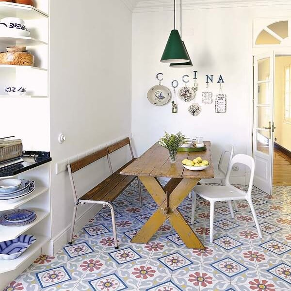 With its colorful encaustic tiles and mis-matched furniture, this kitchen epitomizes eclectic-chic.