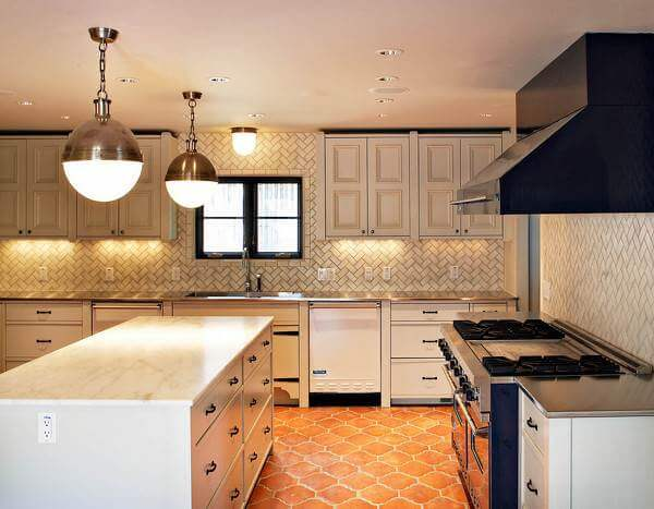 Arabesque terracotta tiles paired with basket weave set wall tiles hint at  rustic charm in this modern kitchen.