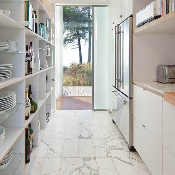 white marble tiles add to the light and airy feel in this compact kitchen - Kitchen Floor Designs