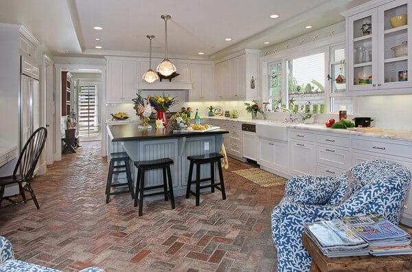 Reclaimed terracotta brick tiles give this contemporary farmhouse kitchen a timeless elegance.