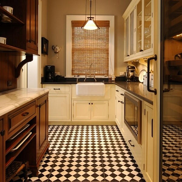 Small checkerboard tiles are a good choice in a traditional kitchen design.