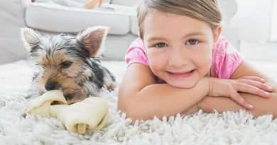 girl and dog on rug