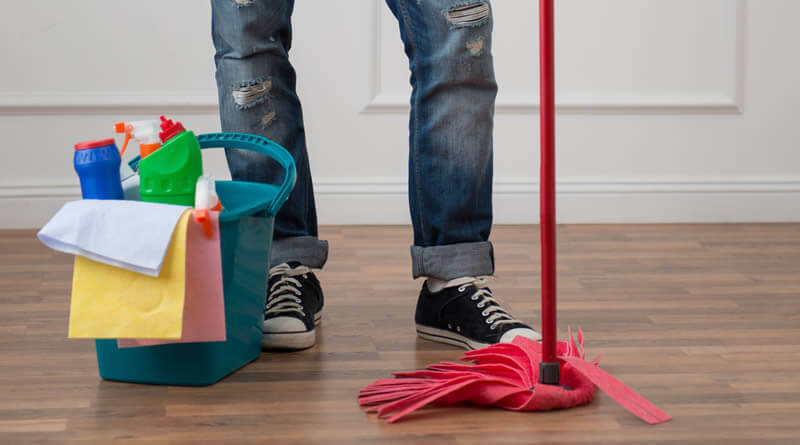 man mopping floor with new mop